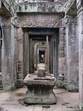 Photo: PHOTO OF THE DAY: REGAL RUINS IN PREAH KHAN  I took this photograph at the Preah Khan temple, once occupied by a great Khmer king – the structure you see at the middle of the cross-section of consecutive hallways is a lingam-yoni shrine. Can you guess what it symbolizes?  Clue: http://www.catherinehall.net/blog/?p=5386.
