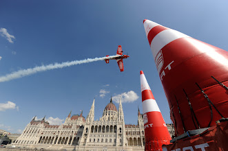 Photo: German Pilot Matthias Dolderer flies through an air gate in front of the Hungarian Parliament on the last training session ahead of the fourth round of the 2009 Red Bull Air Race World Championship in Budapest, Hungary, August 18, 2009. For further information go to www.redbullairrace.com . (Tom Lovelock/Red Bull Air Race via AP Images). FOR EDITORIAL USE ONLY
