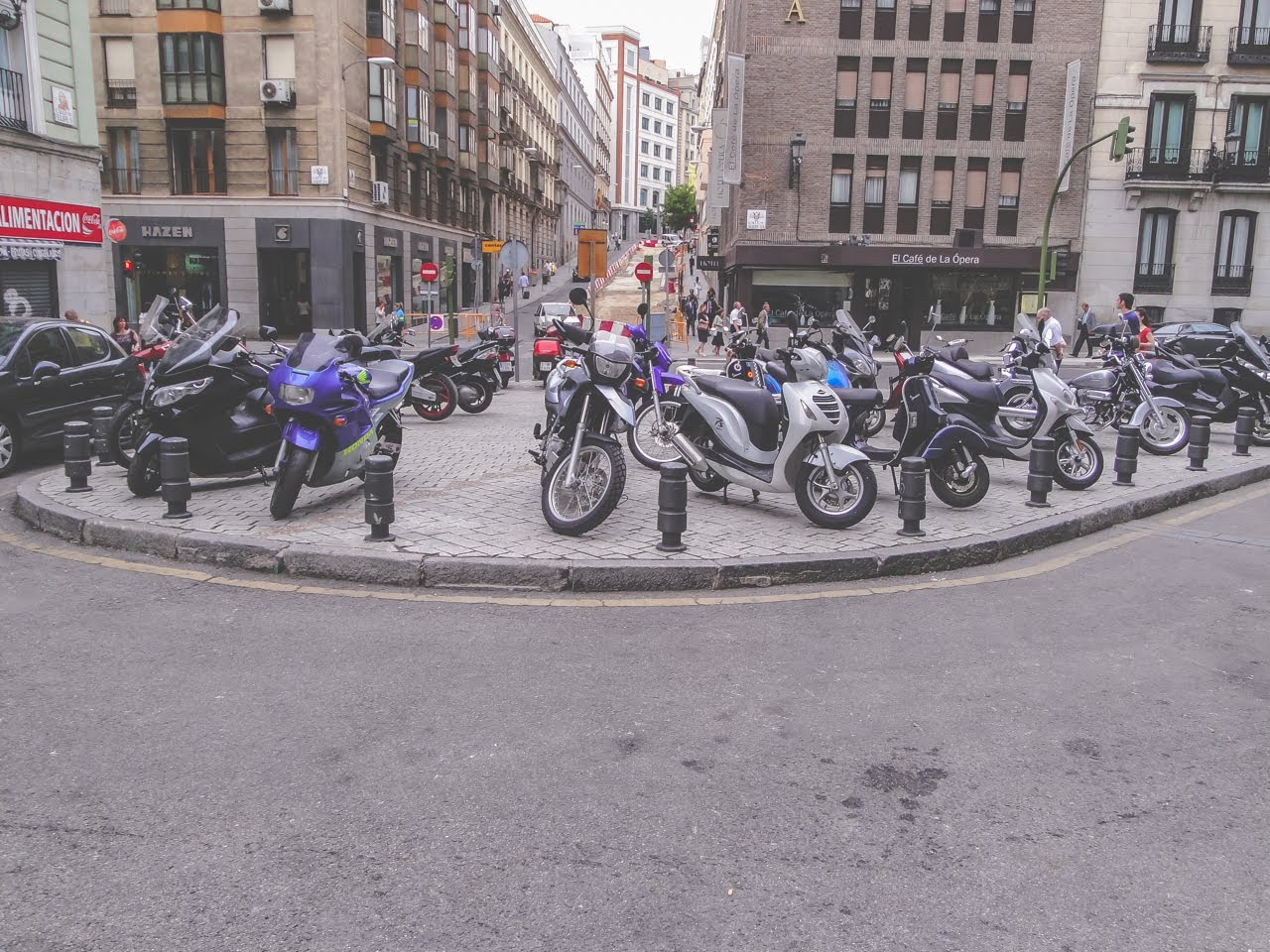 A large number of mopeds line this area