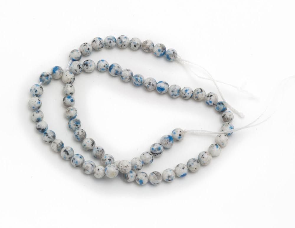 K2 Jaspis, pärla på tråd
