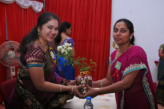 Photo: Smt. APARNA, Chief Patron being honored by Ms. Deepthi