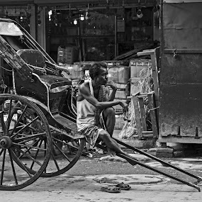 The Rickshaw Puller mood by Ritwik Ray - Black & White Street & Candid ( street scene )
