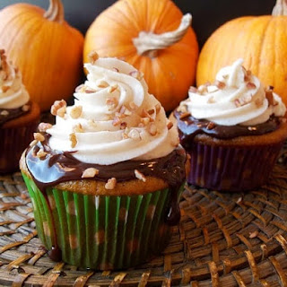 Pumpkin Cupcakes with Chocolate Ganache and Spiced Cream Cheese Frosting.