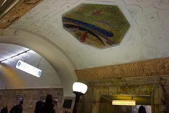 Photo: View of the ceiling at the Novokuznetskaya station. A steam train over a bridge mosaic. https://en.wikipedia.org/wiki/Novokuznetskaya
