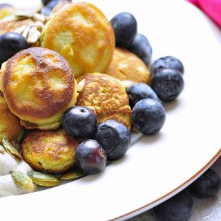 Avocado Pancakes With Cashew Cream And Fresh Blueberries.