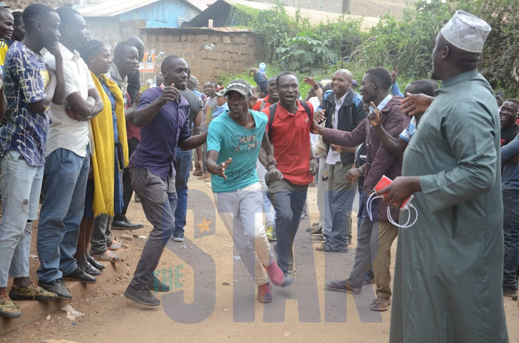 Kibra residents engage in games after voting closed on Thursday, November 7, 2019.