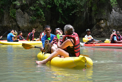 Monkey jumping from kayak to kayak