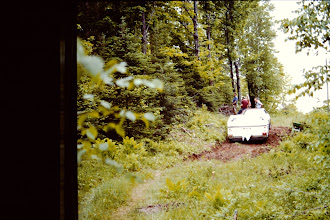 Photo: Struggling to pull the camper to the top of the hill with the car and an assist from the come-along winch and bodies sitting on the hood of the car for traction.