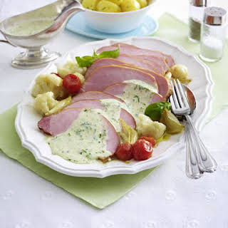 Roast Ham With Vegetables and Herb Sauce.