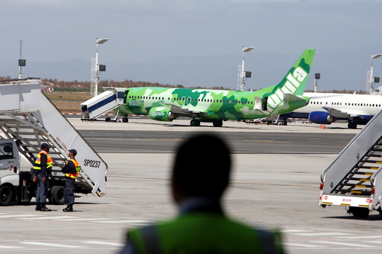 Passengers prepare to disembark from a kulula plane at Cape Town International Airport.   Picture: SUNDAY TIMES