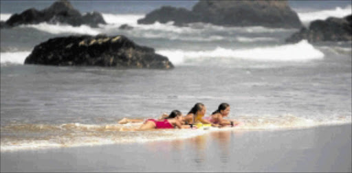 BEACH BABES: Holiday-makers in Plettenberg Bay, about 600km from Cape Town. Photo: Marianne Schwankhart