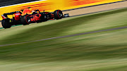 Max Verstappen of the Netherlands driving the (33) Aston Martin Red Bull Racing RB16 during practice for the F1 Grand Prix of Great Britain at Silverstone on July 31, 2020 in Northampton, England.