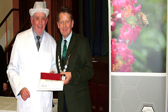 Photo: Tom Canning receiving his Honey Badge Certificate from President Bill Turnbull.