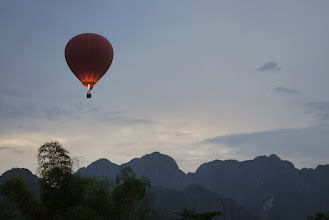Photo: Hot air balloon spotted across the Vang Vieng's sky - perfect ending to our short stay here.