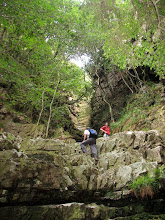 Photo: Surmounting the low cliff