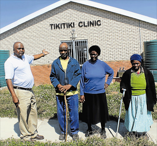 FED UP: Tikitiki village residents, from left, community leader Bless Rosi, Maza Phanda, Caroline Ngquba and Cecilia Njokweni still have to spend R36 to travel nearly 15km to get to the nearest hospital despite having this R12-million state-of-the-art clinic built by government in their village early last year Picture: SIKHO NTSHOBANE