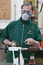 Photo: ... then turns a tenon to put into the chuck he is holding.