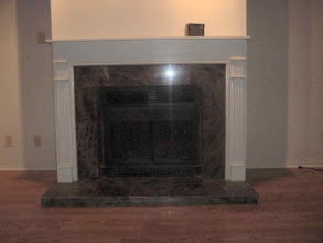 Photo: finished look fireplace surround W/ black marble.