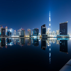 Dubai Night.. by Wissam Chehade - Buildings & Architecture Architectural Detail ( water, pwcarcreflections, reflections, cityscape, landscape, business, lights, sky, towers, bay, dubai, khalifa, uae, buildings, burj, long exposure, night, downtown,  )