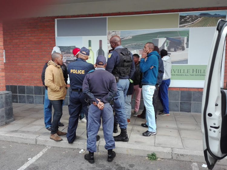 A group of protesters gathered at the Prestons Liquor Store in Walmer in June 2018.