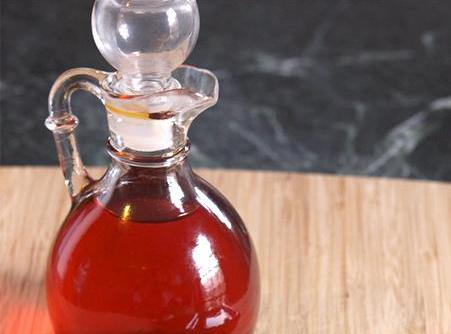 Strain into a glass container with a tight fitting top. You could also cook it...
