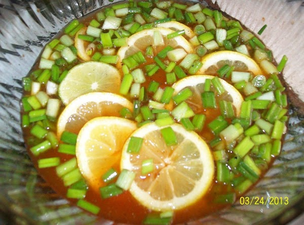 Slice the green onions, lemon & lime and add to the pop mixture.