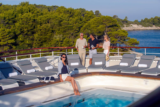 Ponant-Yacht-Cruise-poolside.jpg - Relax poolside as your Ponant ship slips into small bays and secluded coves.