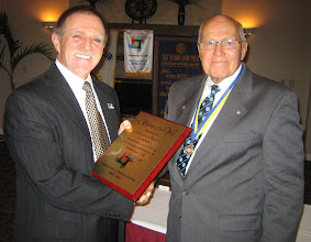 Photo: Rotarian of the Year award presented to Incoming President Dennis by President Blaine, for Dennis' efforts in running a successful Golf Tournament!