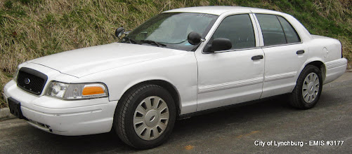 Photo: Lot 16 - (3177-1/7) - 2011 Ford Crown Victoria - 103,377 miles
