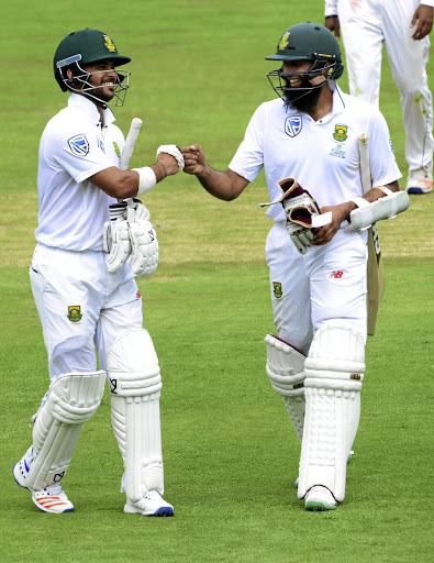 Ton-up boys: JP Duminy, left, and Hashim Amla put on a 292 third-wicket partnership at the Wanderers on Thursday. Picture: GALLO IMAGES/LEE WARREN