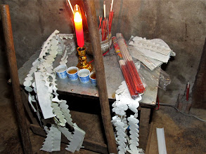 Photo: altar to the ancestral spirits in Yeng's home