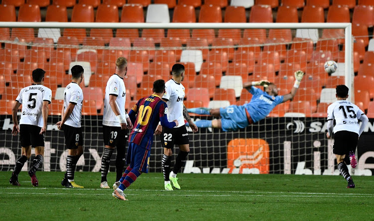 Barcelona's Lionel Messi scores from a free kick against Valencia at Mestalla, Valencia on May 2, 2021