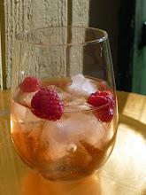 Photo: La Vie en Elderflower cocktail: Dry rose wine, St-Germain elderlfower liqueur, club soda, rasberries.