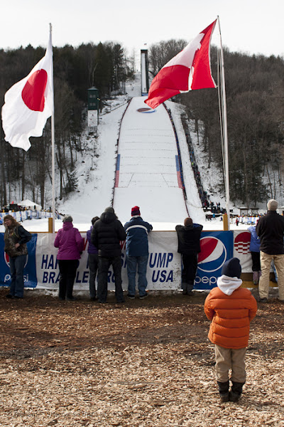 Photo: A young boy watches as skiers compete at the Harris Hill Ski Jump in Brattleboro on Saturday.(Zachary P. Stephens/Brattleboro Reformer)