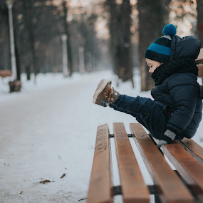 Enjoying cold by Stefan  Gavrilescu - Babies & Children Toddlers ( cute baby, winter, bench, cold, blue, happy, sunset, beautiful, snow, children, warm clothes, cute )