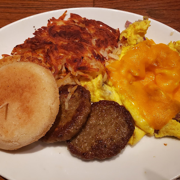 Scrambled eggs, hash Browns, sausage and gluten free english muffin