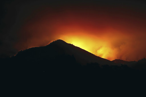 A hill is silhouetted by the flames of the Nuns Fire in Kenwood, California, on October 10 2017. Picture: REUTERS