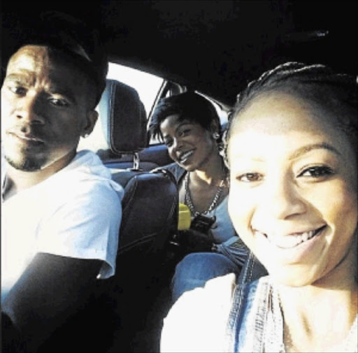 Senzo Meyiwa, Kelly Khumalo, and her sister Zandi Khumalo in the back.