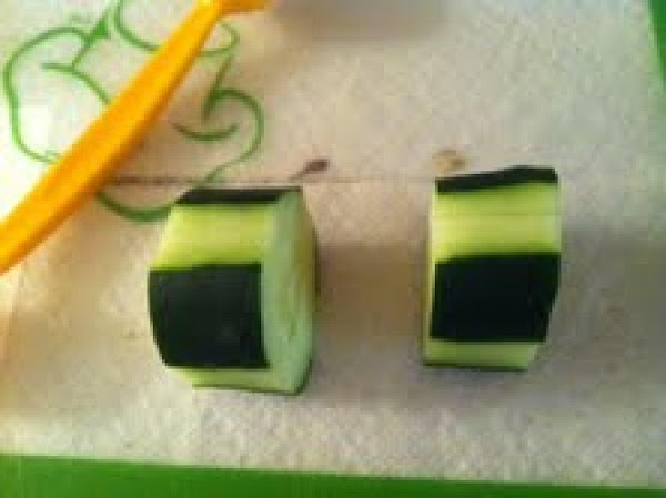 Cut cucumbers into 1 to 1-1/2 inch thick slices.  All slices should be...