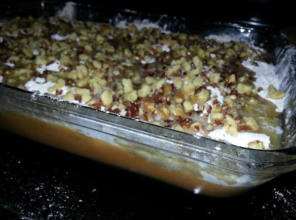 Sprinkle cake mix evenly over batter. Pour melted butter over cake mix. Sprinkle nuts...