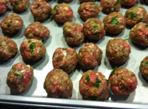 Meatballs; mix all your ingredients for the meatballs.  Using a cookie scoop or...
