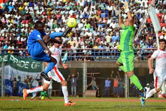 Photo: Alhassan 'Crespo' Kamara, chips the keeper only to have it cleared from the line by a Tunisian defender [Leone Stars vs. Tunisia, June 2013 (Pic: Darren McKinstry)]