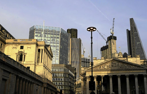 The Bank of England is seen against the backdrop of London's financial district. Picture: REUTERS