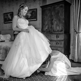 I can't do up my shoelaces! by Jamie Ledwith - Wedding Getting Ready ( b&w, candid, wedding, black and white, preparation )