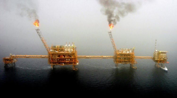 Gas flares from an oil production platform at the Soroush oilfields in the Persian Gulf, south of the Iranian capital Tehran. Picture: REUTERS/RAHEB HOMAVANDI