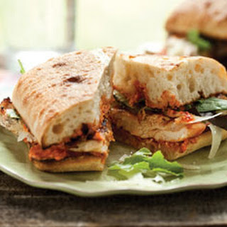 Grilled Chicken Ciabatta Sandwich With Romesco Sauce and Baby Greens