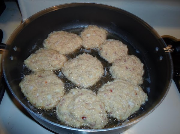 Place patties into hot skillet.