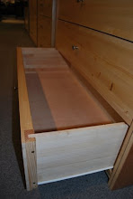 Photo: The front of the drawer is our honeycomb composite and the body of the dresser drawer is all wood construction.  We never use mdf, particle board or cardboard in manufacturing our dresser drawers