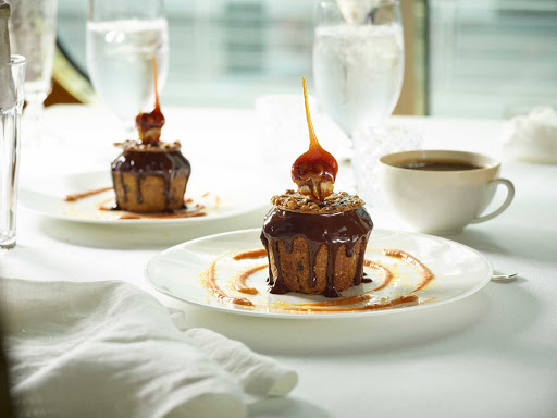 A pumpkin chocolate cake, designed by master pastry chef Jacques Torres, served in the main dining room of your Holland America cruise.