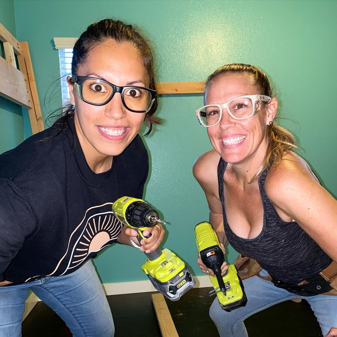 women with tools preparing for DIY garage organization
